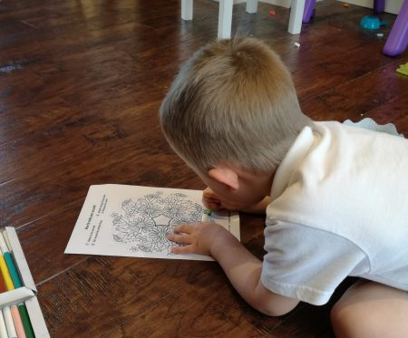 Boy colouring in Easter flowers picture
