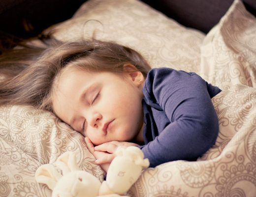 Girl toddler sleeping in a bed