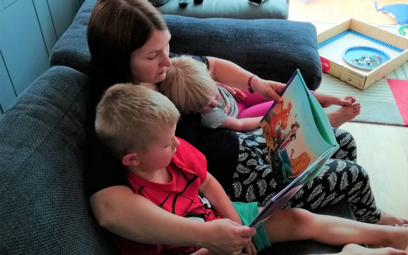 Mum and children sharing a book