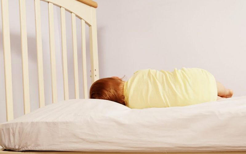 Toddler asleep on Roly Poly pillow