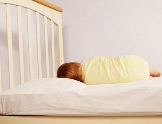Toddler asleep on Roly Poly pillow