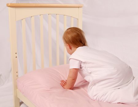 Roly Poly pillow on a cot bed