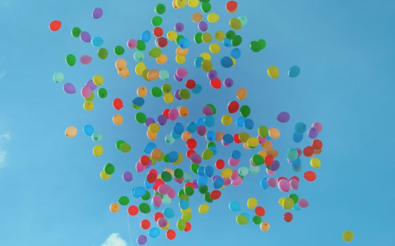 Multicoloured balloons floating in the sky
