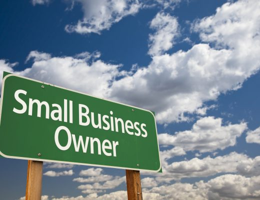 Small Business Owner sign against sky background