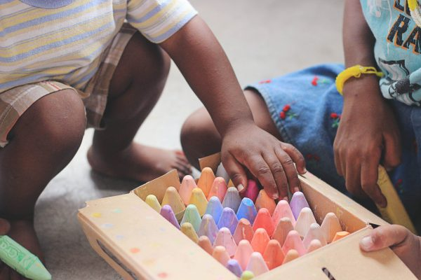 Children playing with chunky chalks