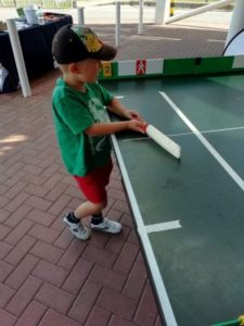 Boy playing table cricket