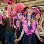 Office party with participants wearing pink