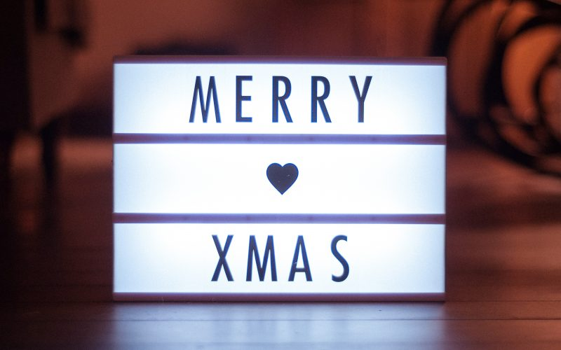 Light box displaying the words Merry Christmas