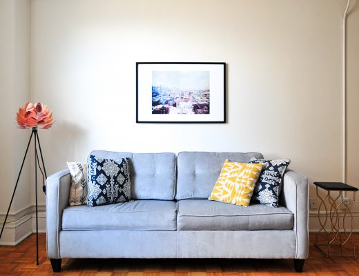 Blue sofa in living room with lamp