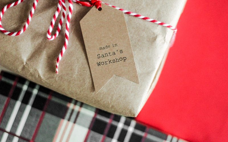 Christmas present with ribbon and tag