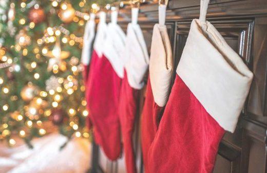 Christmas stockings hung on a fireplace
