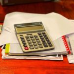Calculator on pile of papers