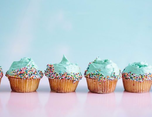 Iced cupcakes with sprinkles