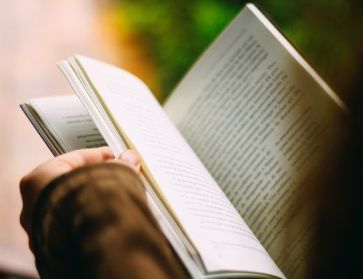 Close up of hands holding open book