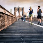 People running along a bridge
