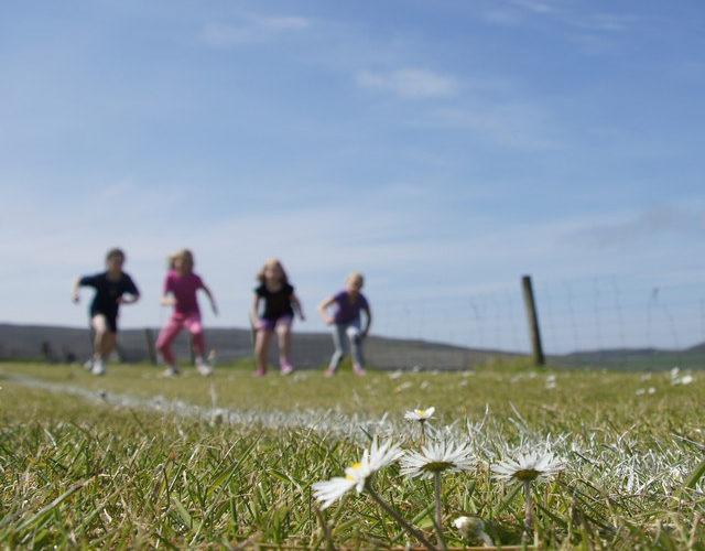 Children running in background