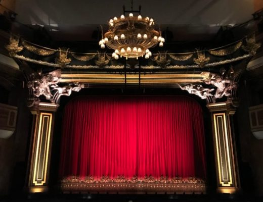Theatre front with red curtains
