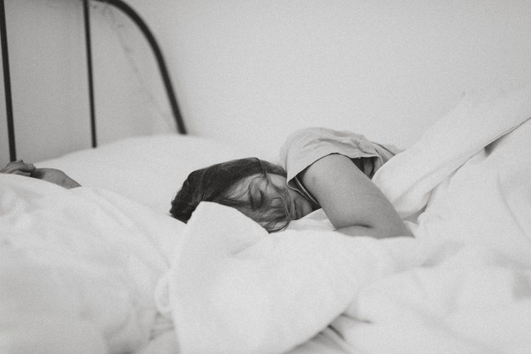Black and white photo of woman sleeping