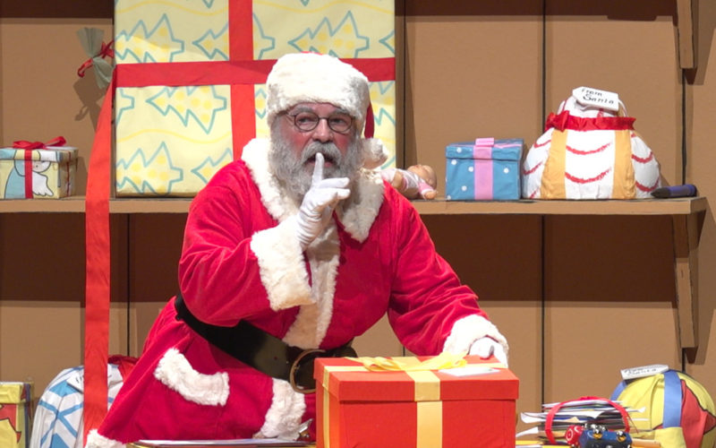 Santa holding his finger to his mouth
