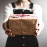 Woman holding out wrapped present