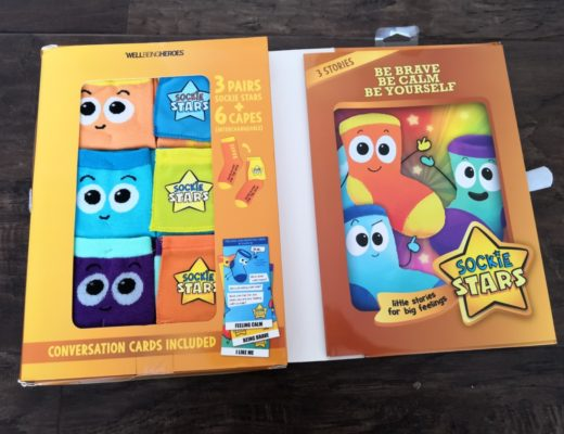 Open package Sockie Stars socks and story book